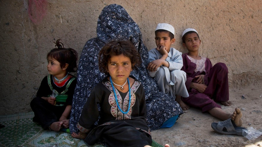 Masooma sits with her children at her brother-in-law's house on the outskirts of Kandahar, Afghanistan on Saturday, April 20, 2013. In an interview, Masooma recounted the events of pre-dawn March 11, 2012 when a U.S. soldier rampaged through two villages killing 16 people, including her husband. U.S. Army Staff Sgt. Robert Bales of Lake Tapps, Washington, is accused of the killings. Bales has not entered a plea, but his lawyers have not disputed his involvement. The Army is seeking the death penalty. (AP Photo/Anja Niedringhaus)