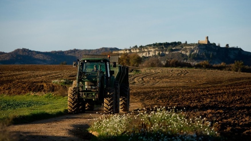 VIC, SPAIN - NOVEMBER 20:  A farmer works with his tractor on November 20, 2012 in Vic, Spain. Over 5 million Catalans will be voting in Parliamentary elections on November 25.  (Photo by David Ramos/Getty Images)