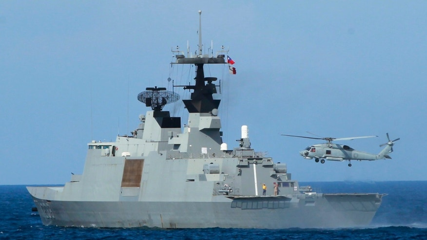 An S70-C helicopter takes off from the stern of a Taiwanese Lafayette frigate during exercises off the southern city of Kaohsiung,Taiwan Thursday, May 16, 2013. Taiwan staged a previously scheduled military exercise in the Bashi Strait Thursday, after the United States on Wednesday expressed concern about increasing tensions between the Philippines and Taiwan, following the shooting of a Taiwanese fisherman by Philippines coast guard personnel. (AP Photo/Wally Santana)