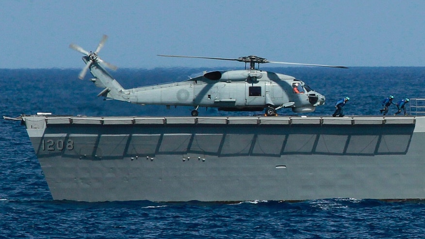 An S70-C helicopter is secured on the helipad of a Taiwanese Lafayette frigate during exercises off the southern city of Kaohsiung,Taiwan Thursday, May 16, 2013. Taiwan staged a previously scheduled military exercise in the Bashi Strait Thursday, after the United States on Wednesday expressed concern about increasing tensions between the Philippines and Taiwan, following the shooting of a Taiwanese fisherman by Philippines coast guard personnel. (AP Photo/Wally Santana)