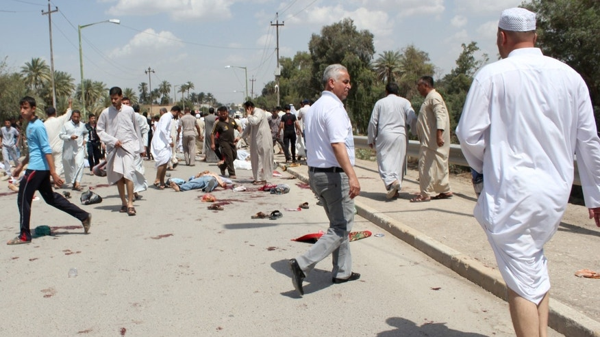 May 17, 2013 - Iraqis gather at the scene of a bomb attack in Baqouba, northeast of Baghdad, Iraq.