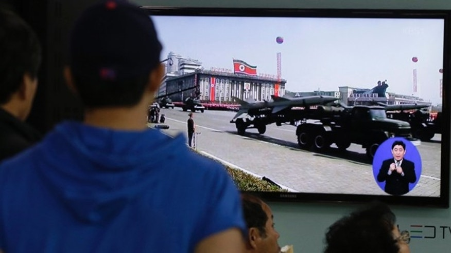 May 18, 2013: South Koreans watch TV news showing a footage of North Korean missiles on a military parade, at a Seoul Train Station in Seoul, South Korea.