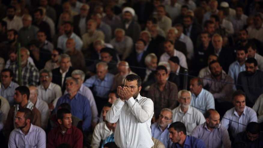 An Iranian worshipper prays at the start of Friday prayers at Tehran University in Tehran, Iran, Friday, May 17, 2013. (AP Photo/Vahid Salemi)