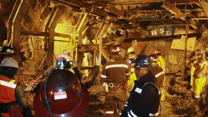 May 19, 2013: In this photo released by PT Freeport Indonesia, the Indonesian unit of Arizona-based Freeport-McMoRan Copper & Gold Inc, rescuers gather inside a tunnel that collapsed on Tuesday morning as they continue the attempt to rescue trapped workers at Big Gossan mining area in Mimika, Papua province, Indonesia.