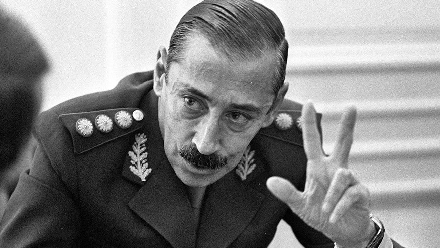 "FILE - In this June 1978 file photo, Gen. Jorge Rafael Videla talks to journalists at the Buenos Aires Government Palace, in Argentina. The former Argentine dictator died of natural causes Friday, May 17, 2013, while serving life sentences at the Marcos Paz prison for crimes against humanity. Videla took power in a 1976 coup and led a military junta that killed thousands of his fellow citizens in a dirty war to eliminate ""subversives."" He was 87. (AP Photo/Eduardo Di Baia, File)"