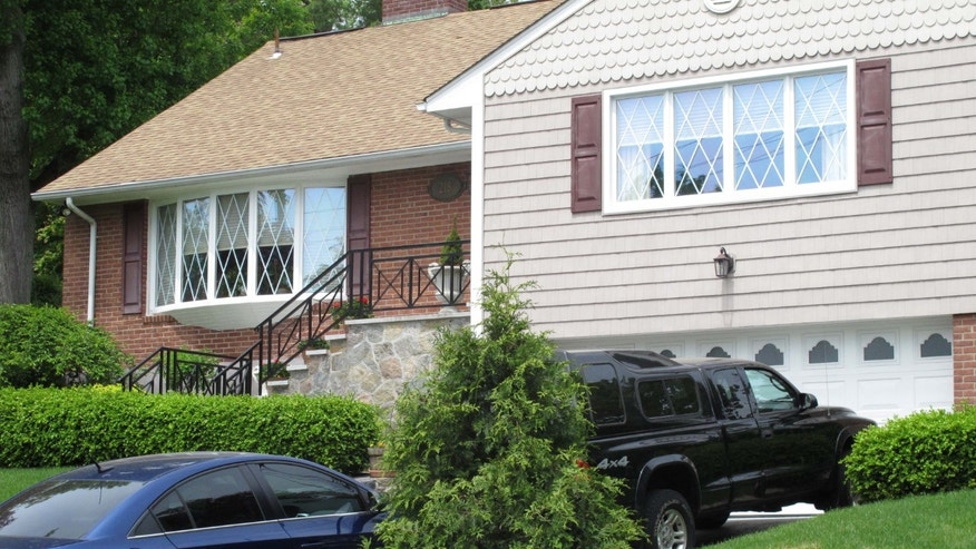 The Tarrytown, N.Y., home of the family of Hofstra University student Andrea Rubello is seen on Friday, May 17, 2013. Police say  Rubello was shot and killed Friday, May 17, 2013, during a break-in near the college campus in Uniondale, N.Y. (AP Photo/Jim Fitzgerald)