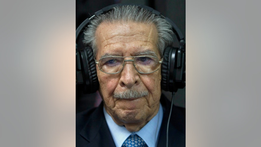 FILE - In this Friday, May 10, 2013 file photo, Guatemala's former dictator Jose Efrain Rios Montt wears headphones as he listens to the verdict in his genocide trial in Guatemala City. Guatemala's top court has overturned the genocide conviction of former dictator Efrain Rios Montt's and ordered his trial to resume. Constitutional Court secretary Martin Guzman says the trial needs to go back to where it stood on April 19 to solve several appeal issues. Monday's ruling comes 10 days after a three-judge panel convicted the 86-year-old Rios Montt of genocide and crimes against humanity for his role in massacres of Mayas during Guatemala's civil war.. (AP Photo/Moises Castillo, File)
