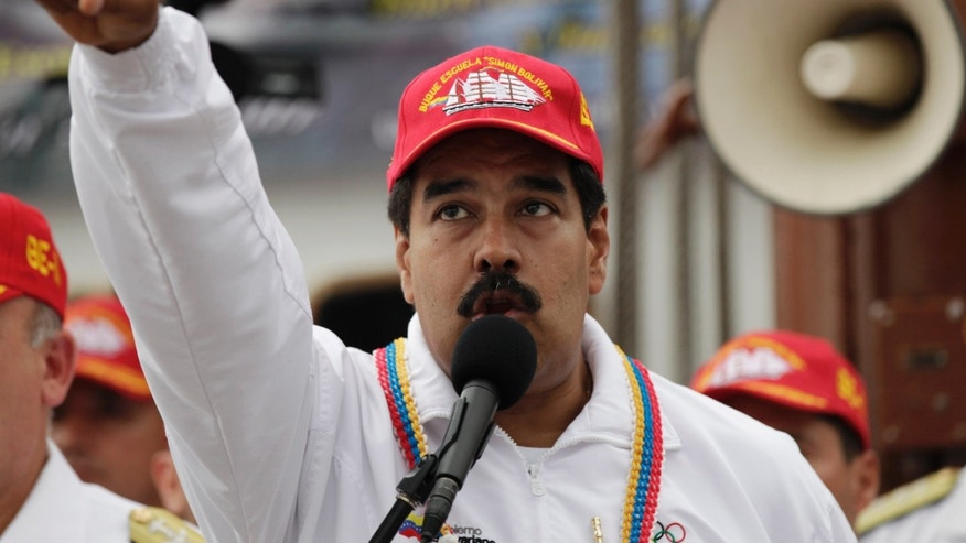 Venezuela's President Nicolas Maduro speaks during the departure of Simon Bolivar's school sailing ship at the naval dock in La Guaira Venezuela, Monday, May 20, 2013. The ship with 175 people on board starts his twenty-fifth cruise abroad instruction. (AP Photo/Ariana Cubillos)