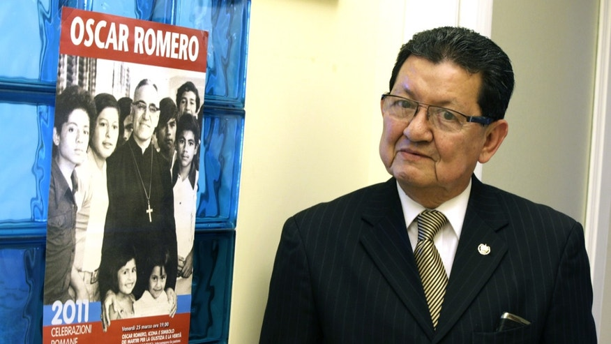 "El Salvador's ambassador to the Holy See Manuel Lopez poses next to a brochure of slain Archbishop Oscar Romero at the end of an interview with the Associated Press, in the embassy's office, in Rome, Tuesday, May 21, 2013. El Salvador's president Mauricio Funes meets with Pope Francis on Thursday amid mounting indications that the stars have finally aligned to move slain Archbishop Oscar Romero onto the first key stage on the path toward possible sainthood. El Salvador now has a government made up of former guerilla fighters who battled the same military hierarchy that Romero denounced and support his beatification. The Vatican now has a Latin American pope who channels many of Romero's concerns for the poor and marginalized. And a generation of Salvadorans who would have been vehemently opposed to a church honor for Romero has passed. President Funes' ""principal objective"" in his whirlwind, one-day trip to see Francis is to encourage ""a push"" for Romero's beatification and to thank Francis for the support he has already shown, El Salvador's ambassador to the Holy See, Manuel Lopez, told The Associated Press. (AP Photo/Andrew Medichini)"