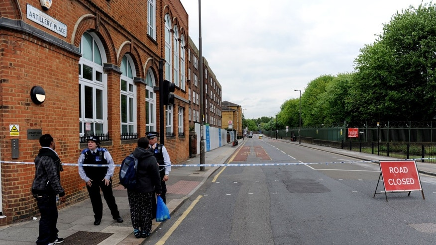 Artillery Place road is closed in Woolwich southeast London near the scene where British officials said one person has died and at least two people have been wounded in an attack on Wednesday May 22, 2013. (AP Photo/Nick Ansell/PA) UNITED KINGDOM OUT