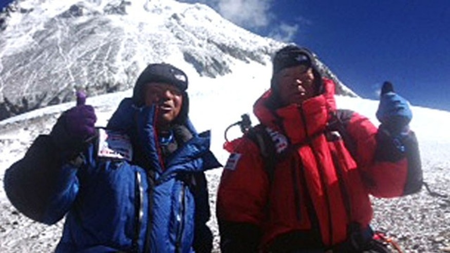 May 22, 2013: 80-year-old Japanese extreme skier Yuichiro Miura, right, and his son, Gota pose at their South Col camp at 26,247 feet before their departure for Camp 5 during their attempt to scale the summit of Mount Everest.