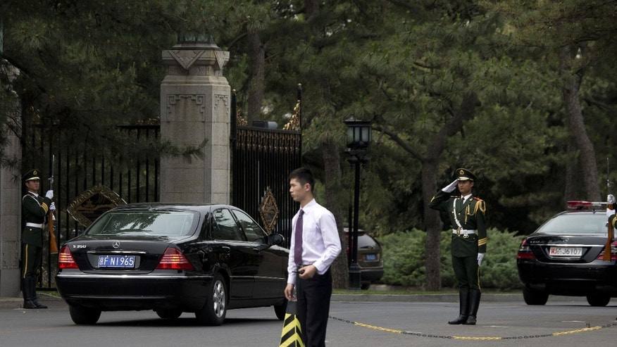 A car, left, believed to be carrying North Korea's Vice Marshal Choe Ryong Hae, a senior Workers' Party official and the military's top political officer, arrives at the Diaoyutai State Guesthouse in Beijing Thursday, May 23, 2013. After months of ignoring Chinese warnings to give up nuclear weapons, North Korean leader Kim Jong Un sent the high-level confidant to Beijing on Wednesday, in a possible effort to mend strained ties with his country's most important ally and a sign that he may be giving diplomacy a chance. (AP Photo/Andy Wong)