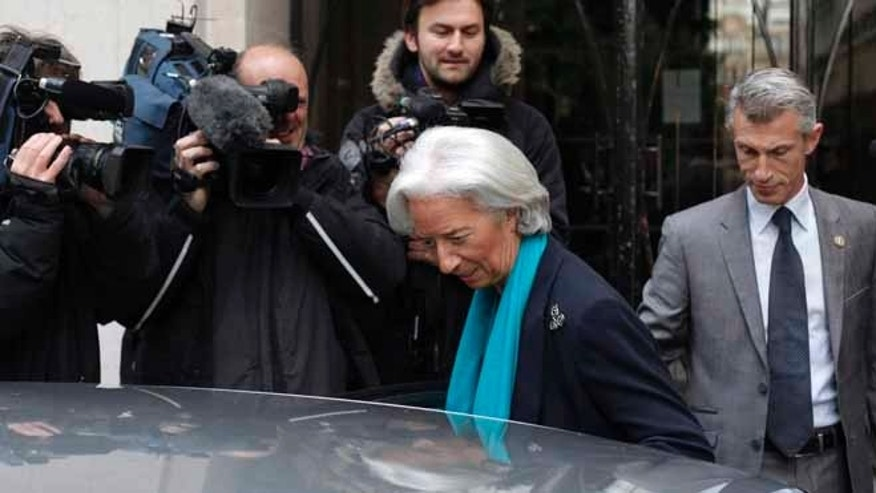 May 23, 2013: IMF Managing Director Christine Lagarde leaves her apartment building for a French court, in Paris. Lagarde is being investigated by the special French court over a controversial arbitrage deal, which she oversaw as French Finance minister in 2008.