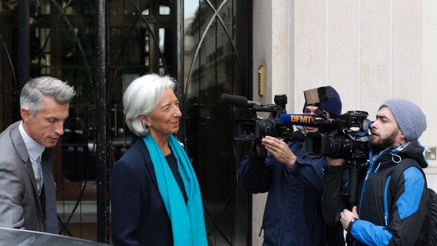 IMF Managing Director Christine Lagarde leaves her apartment building for a French court, in Paris, Thursday, May 23, 2013. Lagarde is being investigated by the special French court over a controversial arbitrage deal, which she oversaw as French Finance minister in 2008. (AP Photo/Thibault Camus)