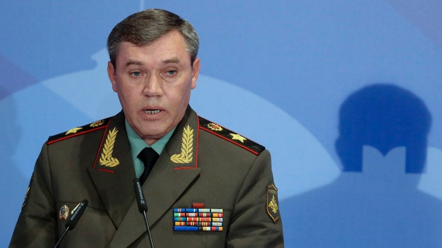 Gen. Valery Gerasimov, the chief of the Russian military's General Staff, speaks during a security conference in Moscow, Russia, Thursday, May 23, 2013. The top Russian military officer has warned the West that Moscow reserves the right to take steps in response to the U.S.-led NATO missile defense plans for Europe if it sees it as a threat.  (AP Photo/Mikhail Metzel)