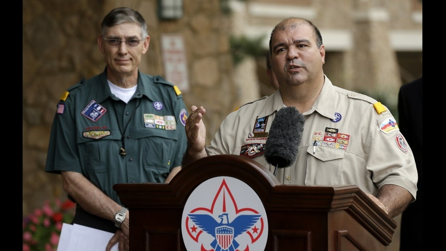 Boy Scouts of America National Commissioner Tico Perez, front, addresses reporters questions as BSA National President Wayne Perry, left, rear, watches Thursday, May 23, 2013, in Grapevine, Texas.