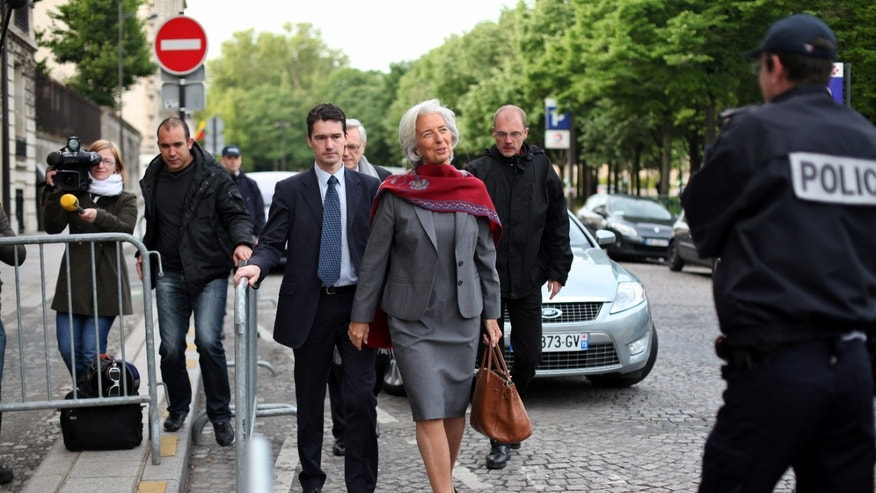 International Monetary Fund chief Christine Lagarde, center,  arrives for a second day of the court hearing at a special court house, in Paris, Friday, May 24, 2013.  Lagarde faced questioning at a special Paris court Friday over her role in the 400 million euro ($520 million) pay-off to a controversial businessman when she was France's finance minister. (AP Photo/Thibault Camus)