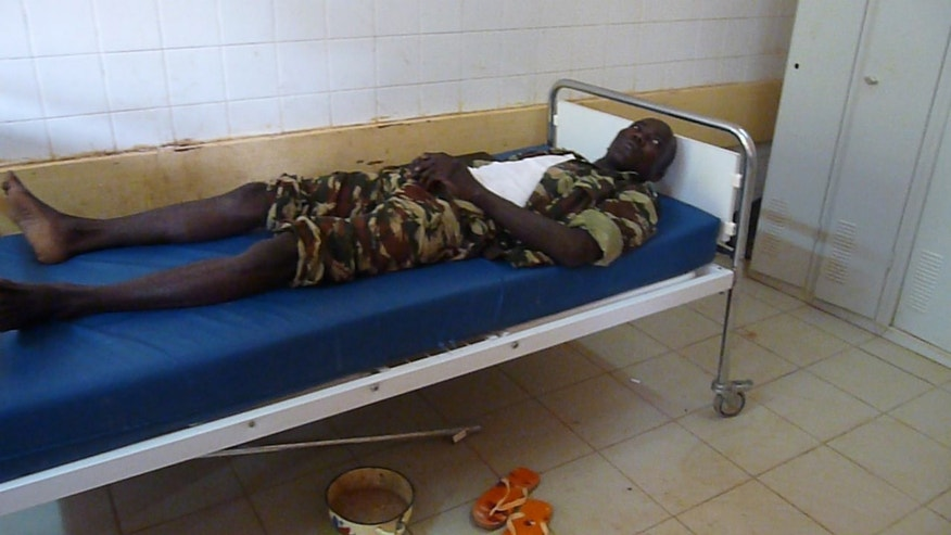 A soldier wounded in a car bombing attack on a military camp, lies in a hospital in Agadez, in northern Niger, Thursday, May 23, 2013. Suicide bombers in Niger detonated two car bombs simultaneously on Thursday, one inside a military camp in the city of Agadez and another in the remote town of Arlit at a French-operated uranium mine, killing a total of 26 people and injuring 30, according to officials in Niger and France. Both attacks were claimed by a spinoff of al-Qaida, the Movement for Oneness and Jihad in West Africa, or MUJAO, which earlier vowed to avenge the four-month-old French-led military intervention which ousted them from town's in Mali's north.(AP Photo)