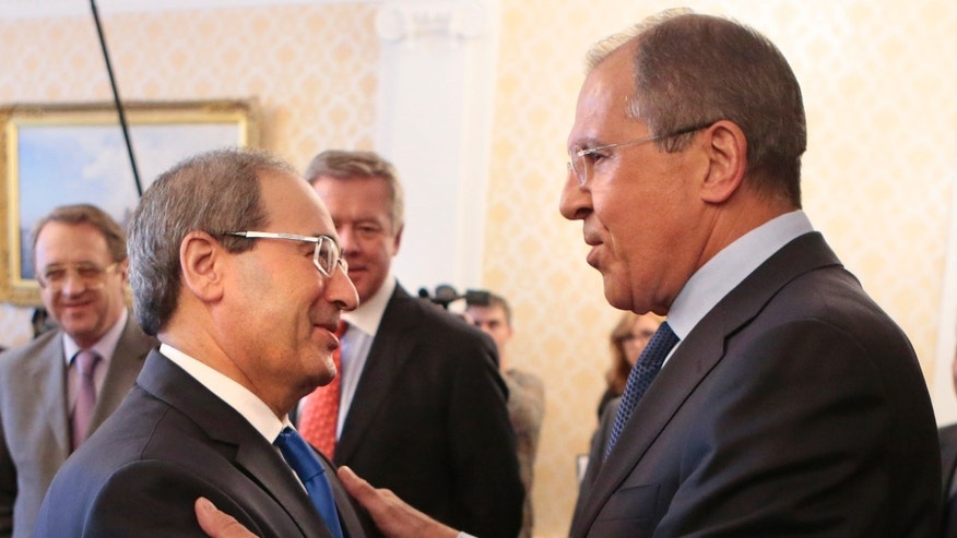 May 22, 2013 - Russian Foreign Minister Sergey Lavrov,  right, greets Syria's Deputy Foreign Minister Fayssal Al-Mekdad, during their meeting in Moscow, Russia.