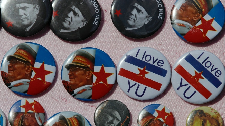 "A street vendor sales badges that show late Yugoslavia's communist leader Josip Broz Tito and badges with old Yugoslav flag that read: ""I love Yugoslavia"" in Belgrade, Serbia, Saturday, May 25, 2013. While banished and vilified during the nationalist euphoria that followed the bloody breakup in the early 1990s', remembering Yugoslavia has since regained in popularity, commanding a steady influx of followers, even among the younger generations that were born after the country disintegrated. The phenomenon is called Yugonostalgia and is often explained as a mental getaway from the disappointments of the brutal reality of postwar and post-communist transition that the citizens of the troubled Balkans have faced since the 1990s'. (AP Photo/Darko Vojinovic)"