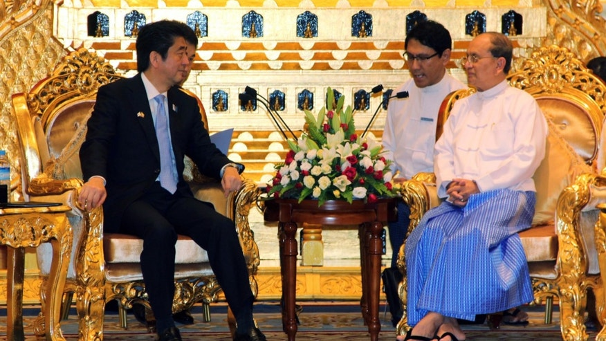 Myanmar President Thein Sein, right, holds talks with Japanese Prime Minister Shinzo Abe, left, during their meeting at Presidential Palace in Naypyitaw, Myanmar Sunday, May 26, 2013. Abe is in Myanmar on the first visit to the country by a Japanese leader in 36 years, as Tokyo bids to reassert its position as a top economic partner after decades of frosty relations with the previous military regime.(AP Photo)
