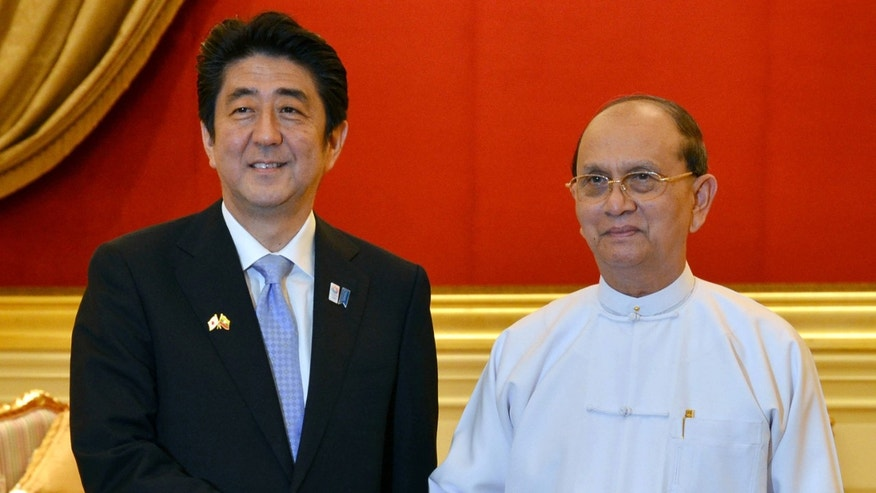 Myanmar President Thein Sein, right, and Japanese Prime Minister Shinzo Abe, left, shake hands at Presidential Palace Sunday, May 26, 2013, in Naypyitaw, Myanmar. Abe arrived in Myanmar on Friday on the first visit to the country by a Japanese leader in 36 years, as Tokyo bids to reassert its position as a top economic partner after decades of frosty relations with the previous military regime.  (AP Photo)
