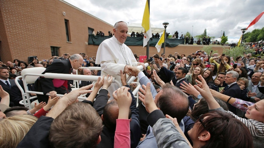 Pope Francis leaves after celebrating a mass in the St. Elizabeth and Zacharia parish church, in Rome, Sunday, May 26, 2013. (AP Photo/Andrew Medichini)