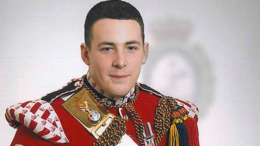 This undated image released May 23, 2013, by the British Ministry of Defense, shows Drummer Lee Rigby, known as Riggers to his friends, who is identified by the MOD as the serving member of the armed forces who was attacked and killed by two men in the Woolwich area of London on Wednesday.