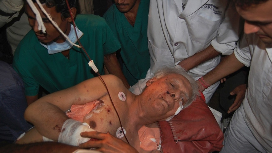 India's former federal minister Vidya Charan Shukla, 83, who was injured in Saturday's Maoist attack in a densely forested area, is brought to a hospital in Raipur, Chhattisgarh state, India, Sunday, May 26, 2013. Officials reacted with outrage Sunday to an audacious attack by about 200 suspected Maoist rebels who set off a roadside bomb and opened fire on a convoy carrying Indian ruling Congress party leaders and members in an eastern state, killing at least 24 people and wounding 37 others. (AP Photo)