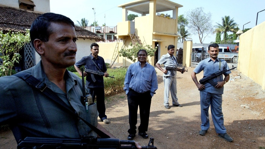 FILE  In this April 15, 2007 file photo, Mahendra Karma, center, lawmaker and founder of Salwa Judum, the government-supported militia to combat Communist rebels known as Naxalites, is surrounded by bodyguards at his residence in Jagdalpur, in the central Indian state of Chattisgarh. Karma was killed when Maoist rebels attacked a convoy of cars of Congress party leaders and supporters in eastern India, injuring several people on Saturday, May 25, 2013. The rebels have been fighting the central government for more than four decades, demanding land and jobs for tenant farmers and the poor. (AP Photo/Mustafa Quraishi, File)