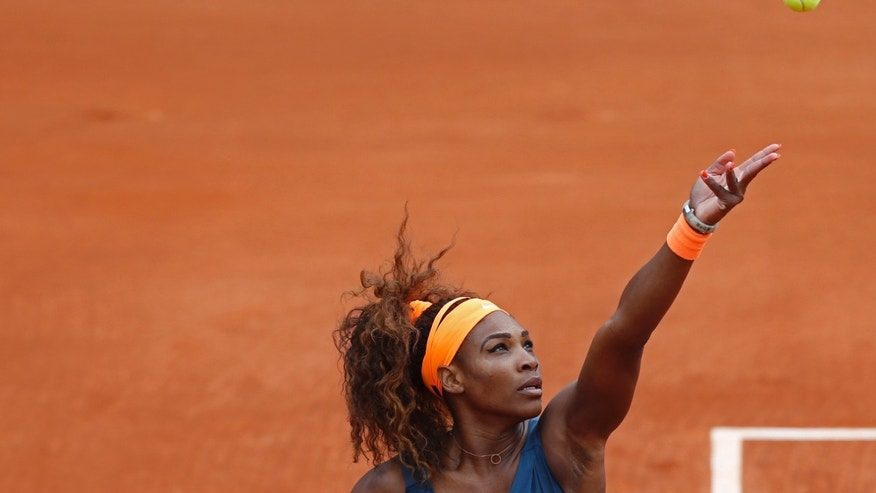 Serena Williams of the U.S. prepares to serve  against Georgia's Anna Tatishvili in their first round match of the French Open tennis tournament, at Roland Garros stadium in Paris, Sunday, May 26, 2013. (AP Photo/Petr David Josek)