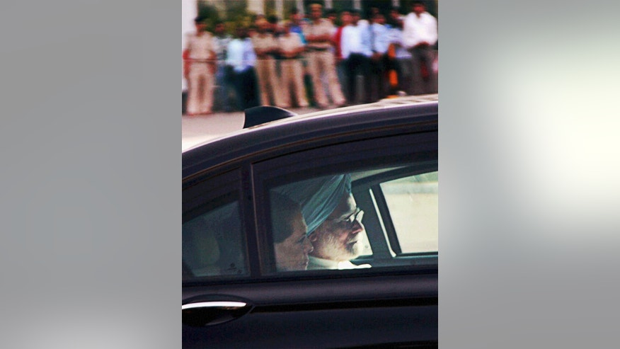 Indian Prime Minister Manmohan Singh, blue turban, and Congress party President Sonia Gandhi, return after visiting Congress party leader Vidya Charan Shukla who was injured in Saturday's Maoist attack in Chhattisgarh state, at a hospital in Gurgaon, India, Sunday, May 26, 2013. Officials have reacted with outrage to an audacious attack by about 200 suspected Maoist rebels who set off a roadside bomb and opened fire on a convoy carrying Indian ruling Congress party leaders and members in an eastern state, killing at least 24 people and wounding 37 others. (AP Photo)