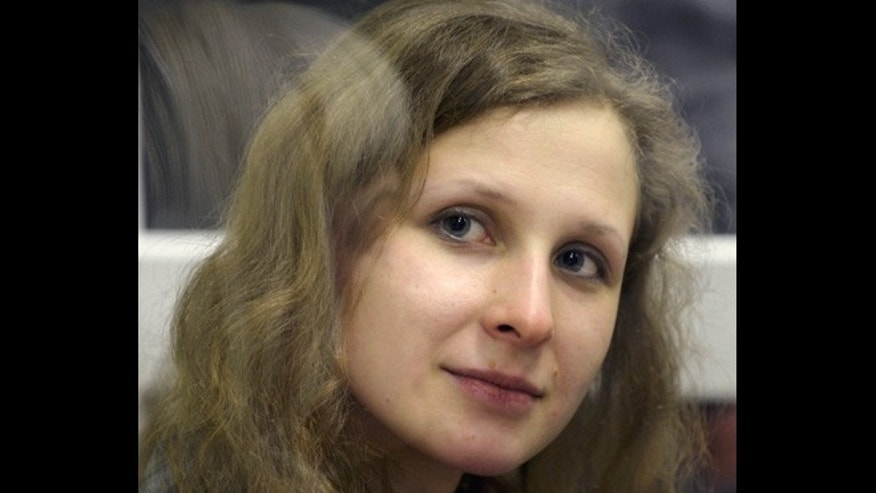In this Wednesday, Jan. 16, 2013 file photo, jailed feminist punk band Pussy Riot member Maria Alekhina is in a defendant's cage in a court room in the town of Berezniki, some 940 miles north-east of Moscow, Russia.