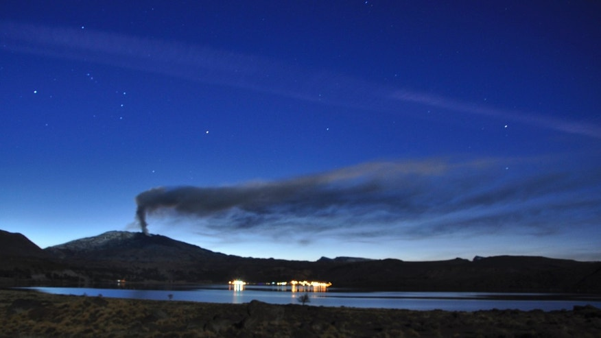 This photo released by the Government of Neuquen, Monday, May 27, 2013, shows a plume of ash and smoke rise from the Copahue volcano, as seen from Caviahue, in the Argentine province of Neuquen, Friday, May 24, 2013. Chile has issued a red alert for the Copahue volcano on the border with Argentina that has become increasingly active. The nearly 10,000-foot (2,965-meter) volcano sits in the Andes cordillera, straddling the border with Argentina's Neuquen province. (AP Photo/Government of Neuquen, Tony Huglich)