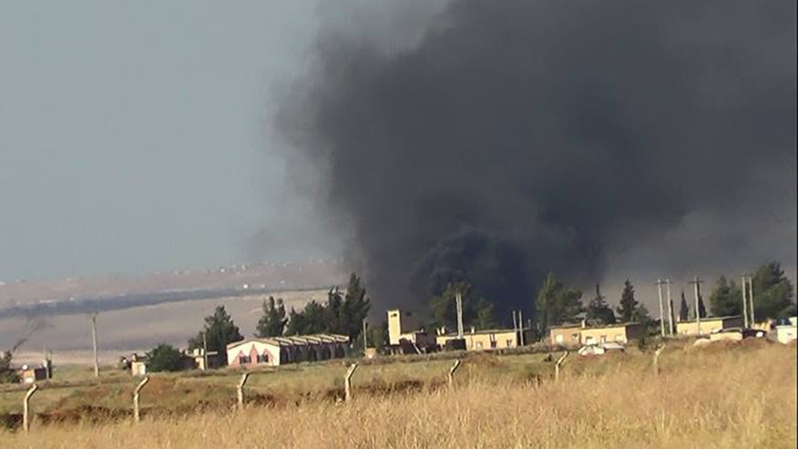 May 17, 2013: Black smoke rises from what rebels say is a helicopter that was shot down at Abu Dhour military airbase which is besieged by the rebels, in the northern province city of Idlib, Syria.