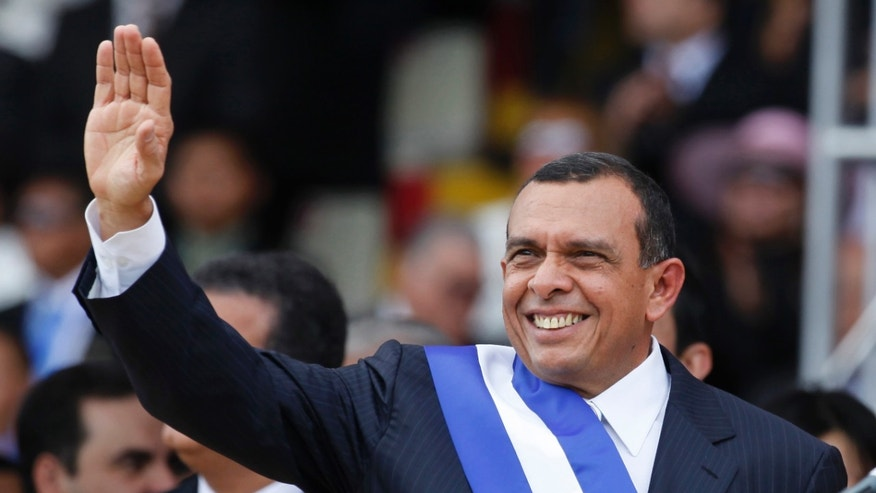 FILE - In this Jan. 27, 2010 file photo, Honduras' President Porfirio Lobo, waves during his presidential inauguration ceremony in Tegucigalpa, Honduras. Lobo said Monday, May 27, 2013 that he is backing efforts to arrange a truce between the country's two largest and most violent gangs. Lobo told The Associated Press that he has called Roman Catholic Bishop Romulo Emiliani of San Pedro Sula to offer his support in bringing peace to Honduras, which has one of highest homicide rates in the world. (AP Photo/Eduardo Verdugo, File)