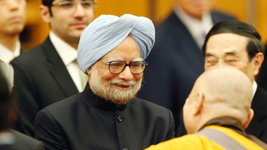 Indian Prime Minister Manmohan Singh talks with Buddhist monks at his lecture in Tokyo, Tuesday, May 28, 2013. (AP Photo/Koji Sasahara)