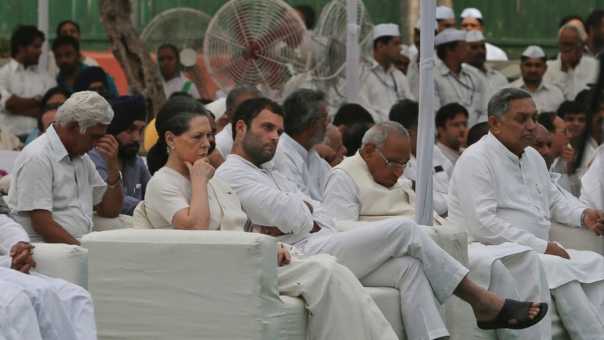 India's Congress party president Sonia Gandhi, fourth right, and vice president Rahul Gandhi, third right, sit at a prayer meeting held at the party's headquarters to pay tribute to those killed in Saturday's Maoist attack in Chhattisgarh in New Delhi, India, Monday, May 27, 2013. Troops fanned out across central India on Monday in a massive manhunt days after hundreds of Maoist rebels attacked a convoy of ruling party members and leaders, killing 24 people in an area considered the stronghold of the rebels, police said. (AP Photo/Manish Swarup)