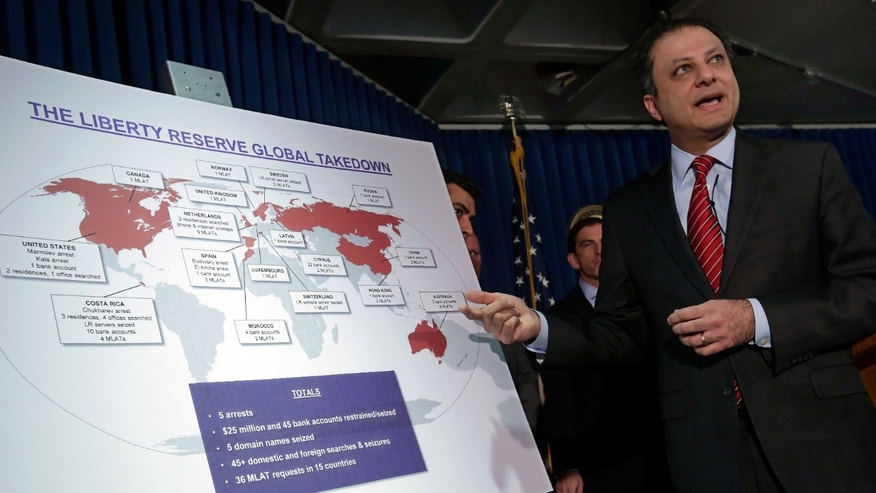 "Preet Bharara, U.S. Attorney for the Southern District of New York, describes a chart showing the global interests of Liberty Reserve, during a news conference in New York, Tuesday, May 28, 2013. Arthur Budovsky,the founder of Liberty Reserve, was indicted in the United States along with six other people in a $6 billion money-laundering scheme described as ""staggering"" in its scope, authorities said Tuesday.(AP Photo/Richard Drew)"