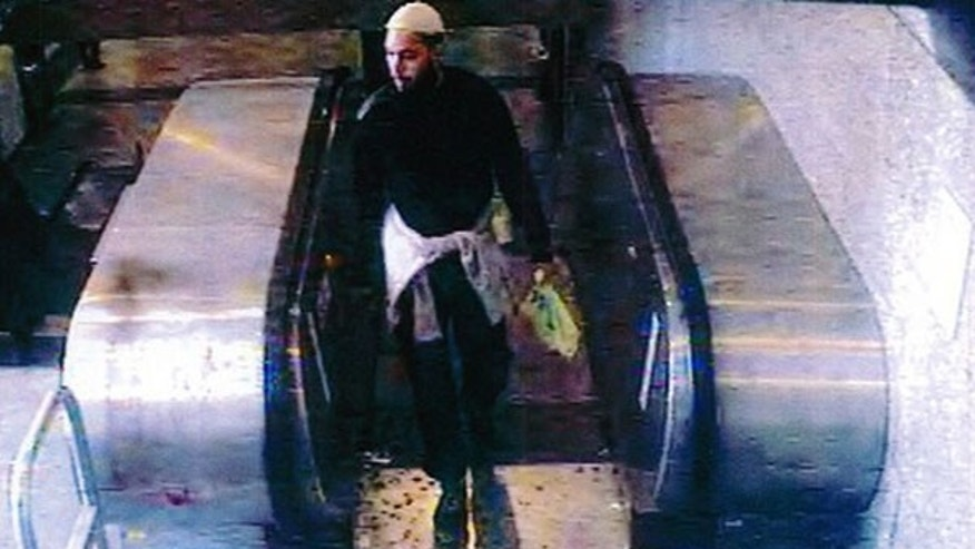 This still image taken from footage taken from a security camera May 25, 2013, and provided by French private TV station M6 on May 29, 2013, shows the 22-year-old French suspect, identified only by his first name Alexandre, as he was strolling in a mall before stabbing a French soldier who was patrolling at the La Defense financial and shopping district, north of Paris, France.