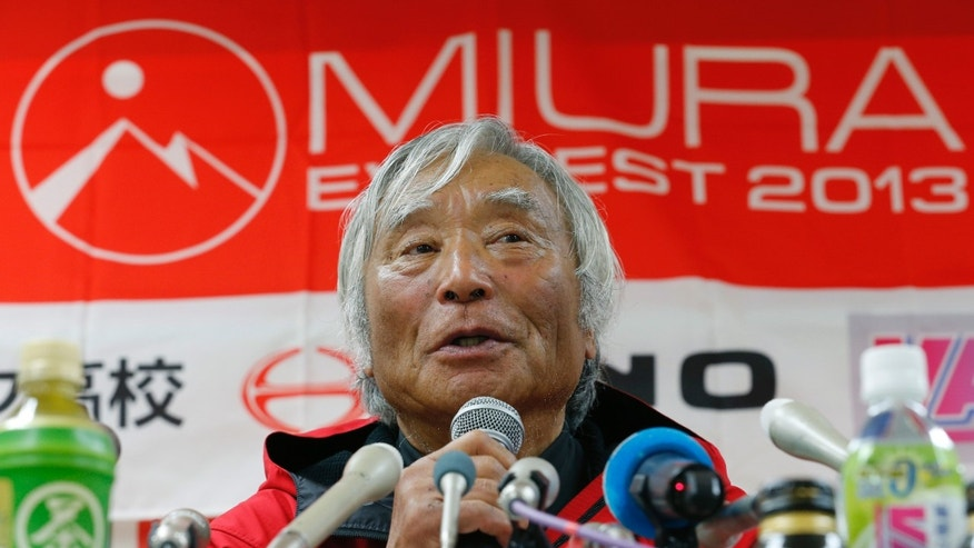 Yuichiro Miura, an 80-year-old Japanese mountaineer who became the oldest person to reach the top of Mount Everest last Thursday, speaks during a press conference at CLARK Memorial International High School in Tokyo, Wednesday, May 29, 2013. Miura said he almost died during his descent and does not plan another climb of the world's highest peak, though he hopes to do plenty of skiing.  (AP Photo/Shizuo Kambayashi)