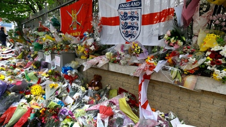 May 28, 2013: Some of the thousands of floral and other tributes left at the scene near Woolwich Barracks in London, where 25-year-old soldier of the Royal Regiment of Fusiliers Lee Rigby was attacked and killed last week.