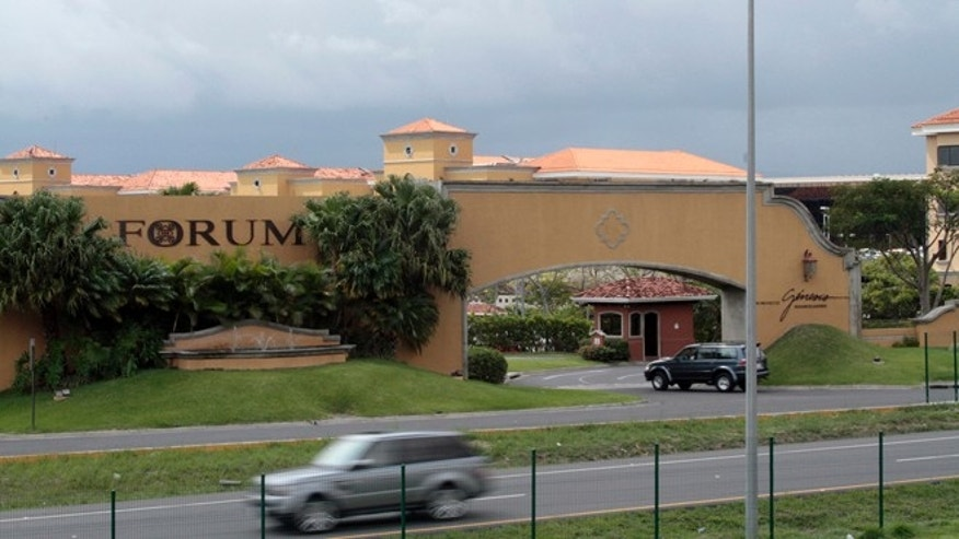 A car drives past the Forum Business Center where two of the businesses linked to Liberty Reserve, Silverhand Solutions and Technology and Cyberfuel.com, are located, 20 kms north-west of San Jose, Costa Rica.