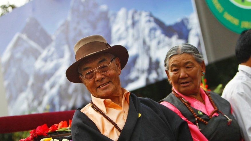 Kancha Sherpa, left, the only survivor of the first successful expedition to Mount Everest participates in a function to mark the 60th anniversary of successful ascent of Mount Everest, in Katmandu, Nepal, Wednesday, May 29, 2013. Edmund Hillary and Tenzing Norgay were the first people to set foot on the peak of Mount Everest on May 29, 1953. (AP Photo/Niranjan Shrestha)