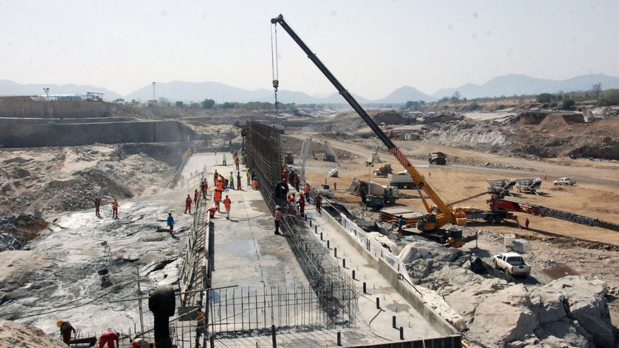 In this photo made Tuesday, April 2, 2013, shows the construction of the dam in Asosa Region Ethiopia.  Ethiopia started to divert the flow of the Blue Nile river to construct a giant dam on Tuesday, according to its state media, in a move that could impact the Nile-dependent Egypt. Downstream nations Egypt and Sudan have objected to the construction, saying it violates a colonial-era agreement which reportedly gives Egypt nearly 70 percent of Nile River waters. (AP Photo/Elias Asmare)