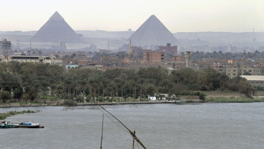 FILE - In this file photo of Tuesday, Jan. 22, 2013, a traditional felucca sailing boat carries a cargo of hay as it transits the Nile river passing the Pyramids of Giza in Cairo, Egypt,  Ethiopia started to divert the flow of the Blue Nile river to construct a giant dam on Tuesday, according to its state media, in a move that could impact the Nile-dependent Egypt. Downstream nations Egypt and Sudan have objected to the construction, saying it violates a colonial-era agreement which reportedly gives Egypt nearly 70 percent of Nile River waters. (AP Photo/Amr Nabil-File)