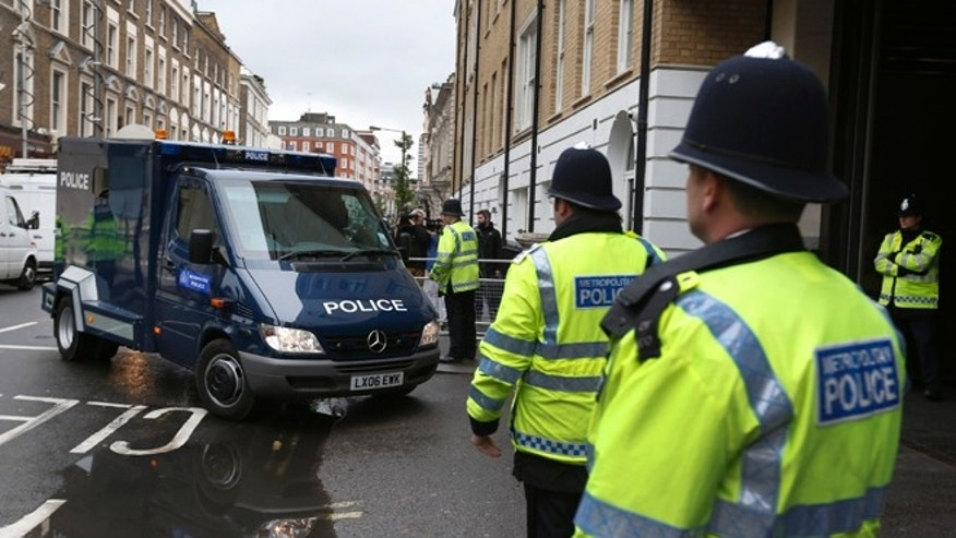 May 30, 2013: A police van allegedly carrying 22-year-old Michael Adebowale, a suspect in the murder of British soldier Lee Rigby,  enters the Westminster Magistrates Court in central London.  Adebowale was charged late Wednesday by counterterrorism officers and will appear in court on Thursday, police said.