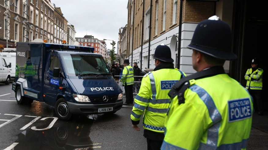 A police van believed to be transporting 22-year-old Michael Adebowale, a suspect in the murder of British soldier Lee Rigby, arrives at Westminster Magistrates Court in central London, Thursday, May 30, 2013. Two men attacked and killed the off-duty soldier in broad daylight, in southeast London's Woolwich area on Wednesday, May 22. They were shot by police and arrested on suspicion of murder. (AP Photo/Lefteris Pitarakis)