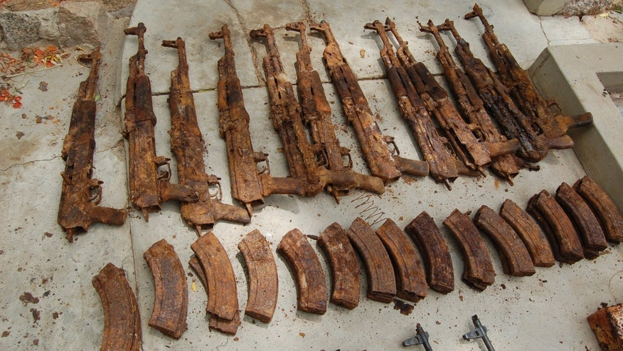 This photo released by the Nigerian Army claims to show displayed corroded weapons, part of an arms cache recovered from a house in Kano, Nigeria, Thursday, May 30, 2013. Nigeria's military and secret police say they've discovered an arms cache in the north's largest city they say belongs to members of the Lebanese political party and militant movement Hezbollah. Officials showed journalists the cache of weapons Thursday. The arms, later shown on the state-run Nigerian Television Authority, appeared to include badly corroded rocket-propelled grenades, land mines, hand grenades and assault rifle magazines. (AP Photo/Nigerian Army)