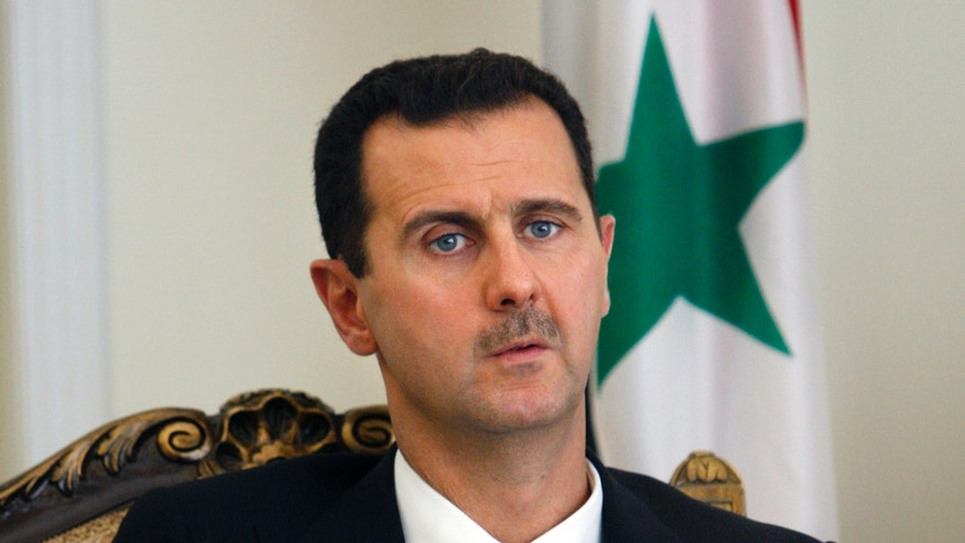 FILE - This Wednesday, Aug. 19, 2009 file photo shows Syrian President Bashar Assad during a meeting with his Iranian counterpart Mahmoud Ahmadinejad, unseen, at the presidency in Tehran, Iran. Assad is quoted by a Lebanese TV as saying the first shipment of Russian air defense missiles has arrived in his country. Al-Manar TV, owned by the militant Hezbollah group, is to air an exclusive interview with Assad later Thursday, May 30, 2013. (AP Photo/Vahid Salemi, File)